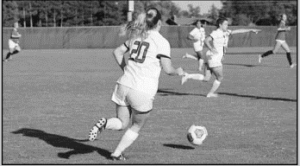 Kaylee Cunningham playing offense during the soccer game.