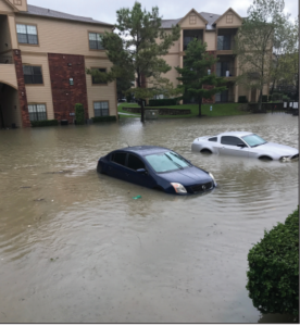 Water levels rose along the sides of cars and an apartment building in Houston, Texas.